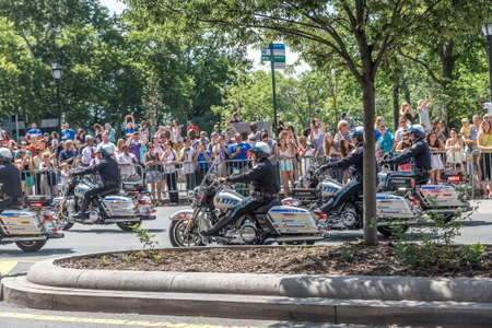 motorcycle officer: NEW YORK - JULY 10: Police officers drive motorcycles during the  parade on July 10, 2015 in NYC. The parade has been organized to celebrate the U.S. womens soccer teams World Cup final win. Editorial