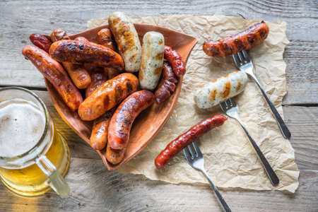 Grilled sausages Фото со стока