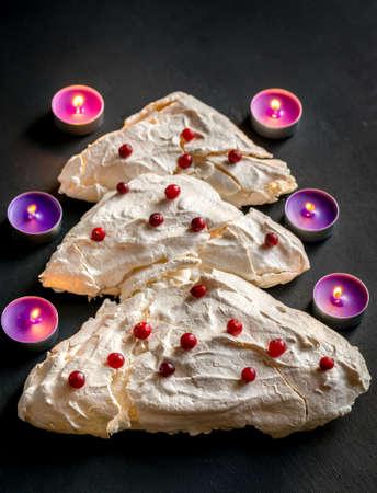candlelit: Christmas tree shape Meringue Stock Photo
