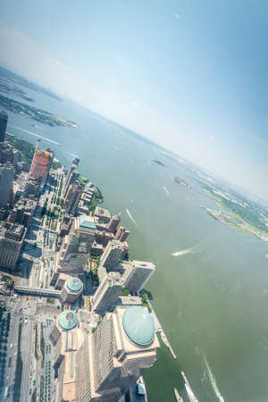 upper floor: NEW YORK CITY - JULY 10: Aerial view of Manhattan on July 10, 2015 in New York. Manhattan is a major commercial, economic, and cultural center of the United States.