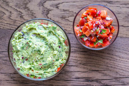 tortilla chips: Guacamole and salsa