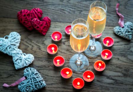 table glass: Candle heart and champagne Stock Photo