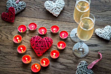 champagne glass: Candle heart and champagne Stock Photo