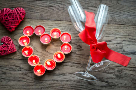 candlelit: Flutes with hearts Stock Photo