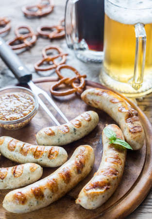 weisswurst: Grilled bavarian sausages with beer Stock Photo