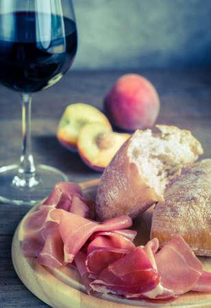 ciabatta: Red wine with ciabatta and prosciutto