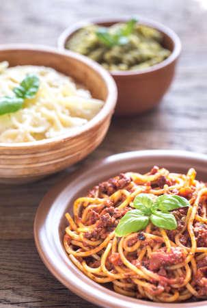 alfredo: Pasta with bolognese, alfredo and pesto Stock Photo