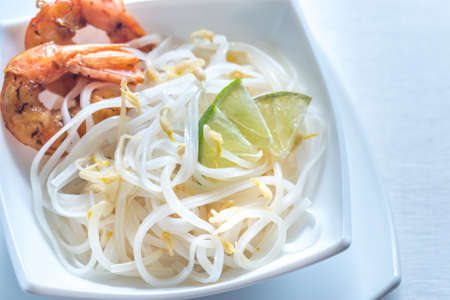 Noodles with shrimps and bean sprouts Stock Photo