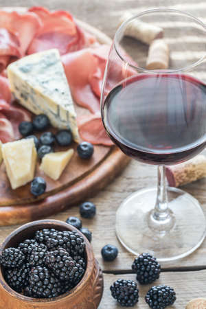 syrah: Red wine with berries and cheese Stock Photo