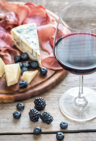 antipasti: Red wine with antipasti Stock Photo