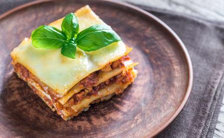 a portion: Portion of lasagna