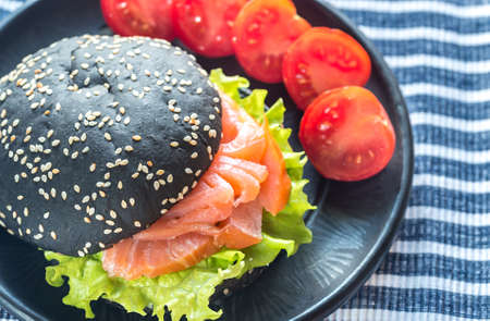 Black sandwich with salmon and cream cheese Stock Photo