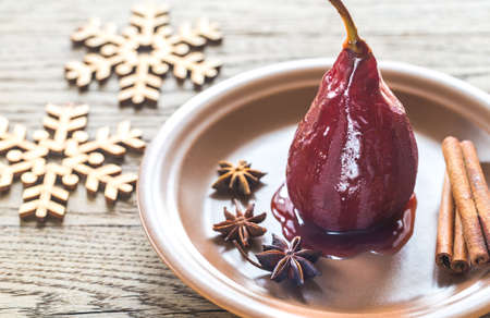 candied fruits: Merlot-poached pear on the plate