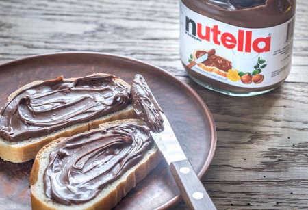 nutella: SUMY, UKRAINE - NOV 3, 2016: Nutella hazelnut spread jar. Nutella is a brand of sweetened hazelnut cocoa spread manufactured by the Italian company Ferrero. Editorial