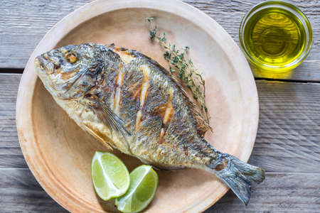 gilt head: Grilled Dorade Royale Fish on the plate Stock Photo