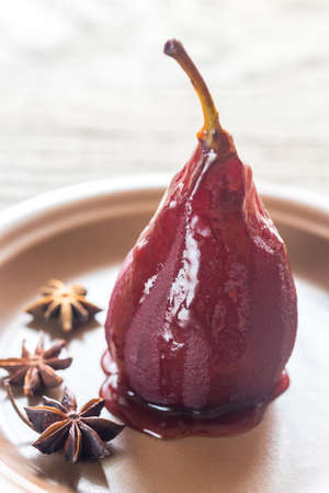 Merlot-poached pear on the plate
