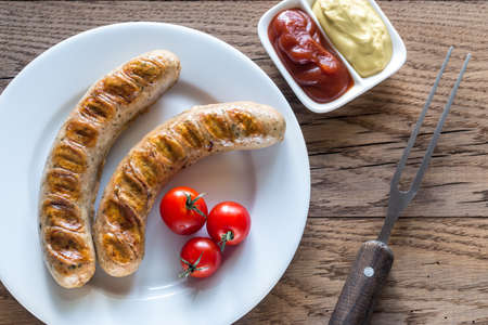 weisswurst: Grilled sausages Stock Photo