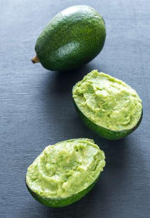 guacamole: Guacamole in avocado shells Stock Photo