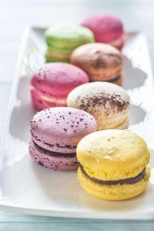 Colorful macarons on the white plate Stock Photo