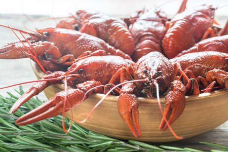 pincers: Bowl of boiled crayfish on the wooden table