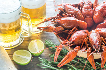 pincers: Bowl of boiled crayfish with two mugs of beer