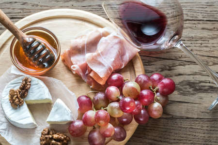 Camembert cheese with glasses of red wine Stock Photo
