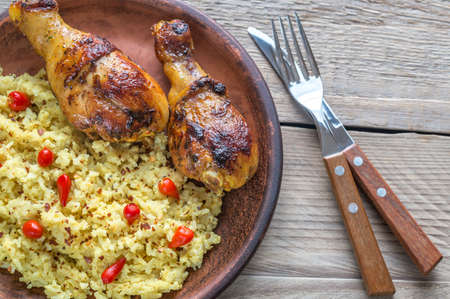 drumsticks: Spicy chicken drumsticks with rice curry Stock Photo