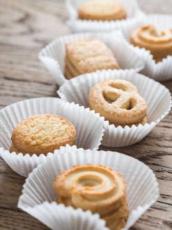 danish: Butter cookies on the wooden table Stock Photo