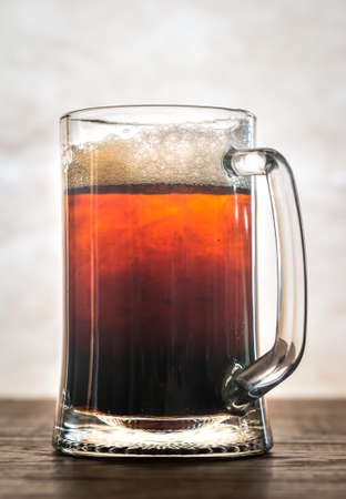 Black and Tan - beer cocktail of pale and dark beer in the mug