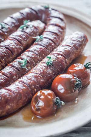 chorizo: Roasted chorizo with cherry tomatoes