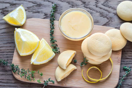 biscuits: Biscuits filled with lemon cream on the wooden board Stock Photo