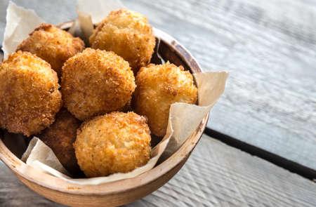 Bowl of arancini - rice balls with mozzarella Stock fotó