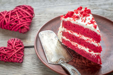 Red velvet cake on the plate Фото со стока