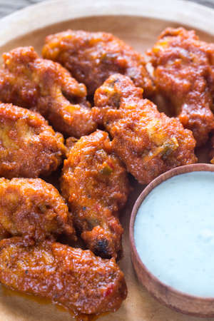 Fried chicken wings with blue cheese sauce