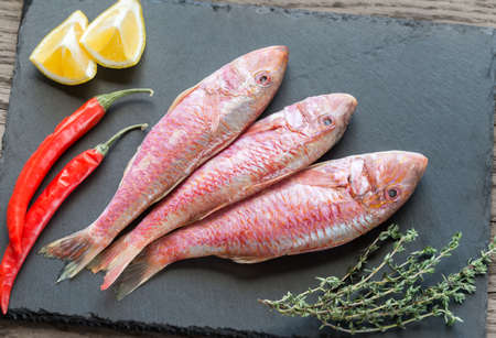 mullet: Raw red mullet with ingredients