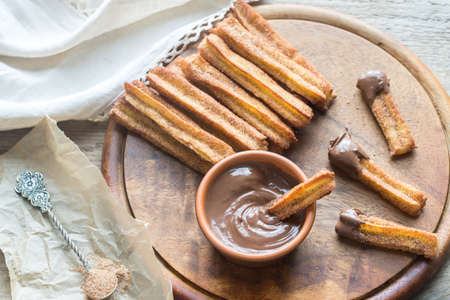 nutella: Churros - famous Spanish dessert with chocolate sauce