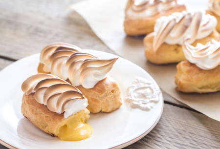 Eclairs with lemon curd and meringue Stock Photo