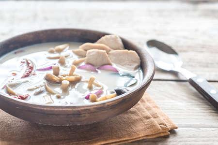 Bowl of thai tom kha kai soup Stock Photo