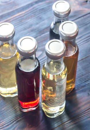 distilled alcohol: Bottles with different kinds of vinegar