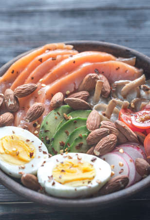 unsaturated: Healthy bowl with salmon, avocado, egg and vegs Stock Photo