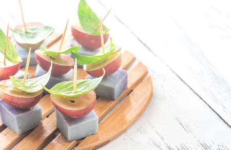 toothpick: Canape with lavender cheese, grapes and basil