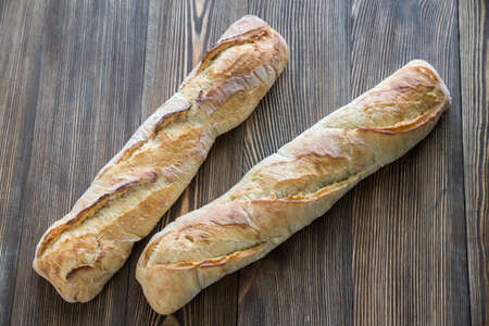 Two baguettes on the wooden background 版權商用圖片