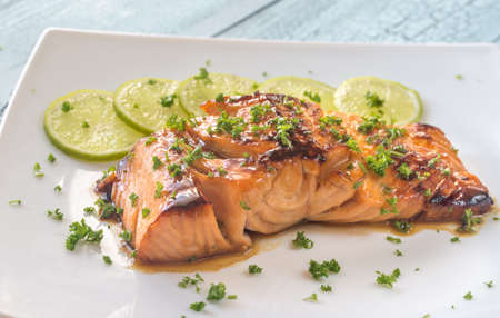 Honey lime salmon on the plate Stock Photo