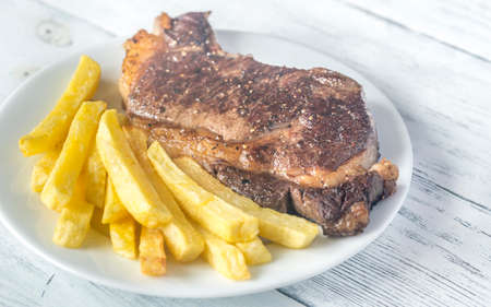 angus: Beef steak with fried potatoes on the plate