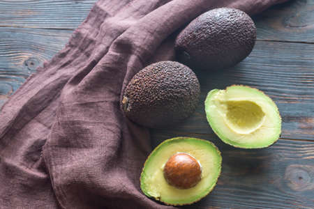 Hass avocados on the wooden background