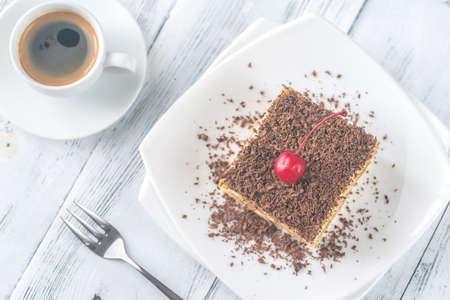 Tiramisu with chocolate topping on the white plate