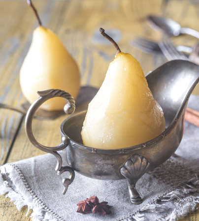 Poached pears in the gravy boat