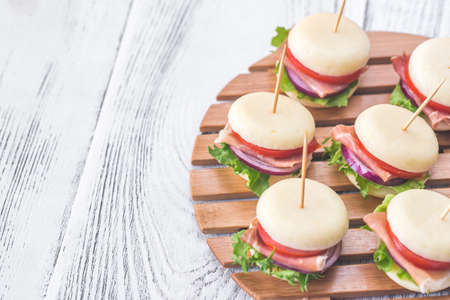 Mini cheese and prosciutto sandwiches