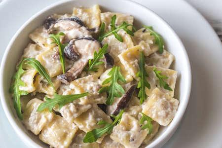 Portion of creamy mushroom ravioletti Imagens