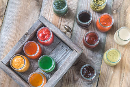 Assortment of sauces in the glass jars Stock Photo - 95921571
